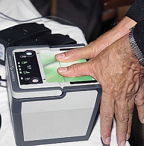 Biometric scanning of fingerprints during the launch of UID enrolment at the General Post Office in Bangalore