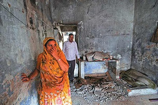 Saira Salim Sandhi Lost her entire family in the riots of 2002. Here she is seen at the charred remains of what was once her home in Gulberg Society, Ahmedabad