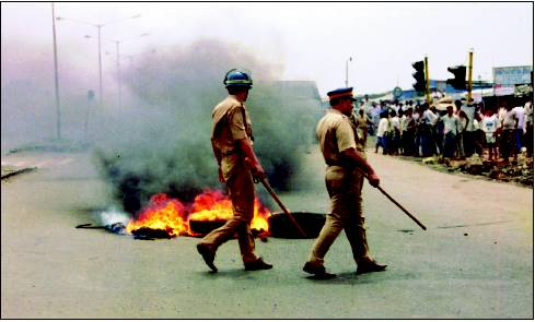 UNDER FIRE Cops at the scene of the riots at Ramabai Ambedkar Nagar in 1997